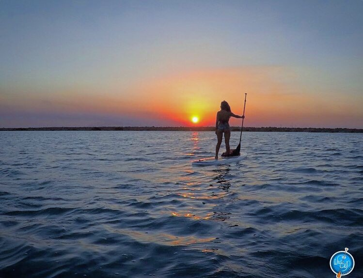 sunset stand up paddle